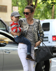 Miranda Kerr did mommy duty looking ultra stylish in a printed cropped jacket and white skinnies.