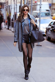 Miranda wore this slouchy boucle coat over her skimpy winter outfit out in NYC.