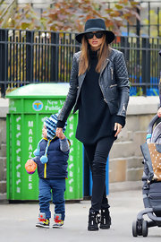 Miranda looked edgy at the playground in this black quilted leather jacket.