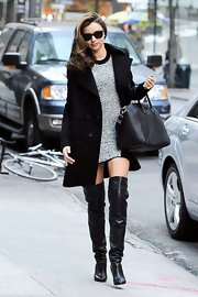 Miranda Kerr turned the sidewalk into a catwalk as she strutted along in these thigh-high leather boots.