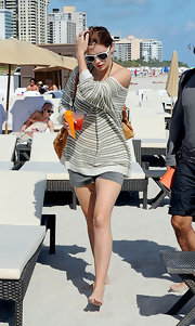 Mischa Barton kept relaxed in a slouchy striped sweater and gray twill shorts.