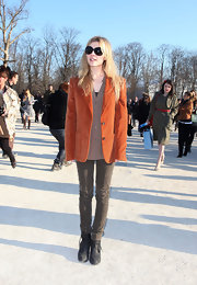 Clemence pays homage to menswear of the 70's in a burnt orange corduroy blazer during Paris fashion week.