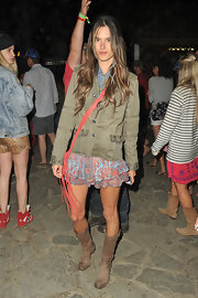 Alessandra Ambrosio rocked an army green utility jacket with studded sleeves and pockets while at Coachella.