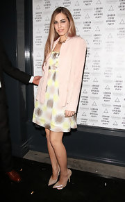 Model Amber Le Bon partnered her dress with a pair of versatile nude pumps at the Eleven Paris Store launch.