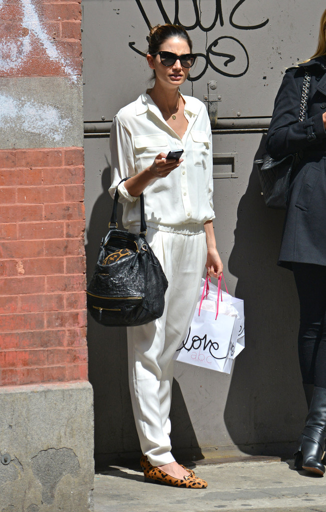 Model Lily Aldridge, dressed in a loose white top and pants, does some shopping in New York City. Aldridge, best known for her work with Victoria's Secret, is married to Kings of Leon lead singer Caleb Followill.