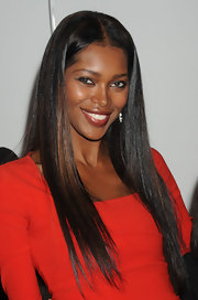Jessica White stepped out in NYC wearing a shimmering gold gloss swept over muted red lipstick.