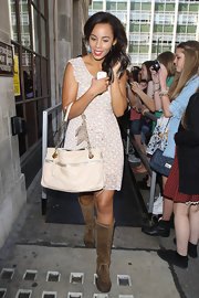 Rochelle Wiseman showed off her cream shoulder bag, which she paired with a print dress.