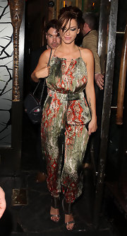 Sarah Harding wore a bohemian print silk jumpsuit while out in London.