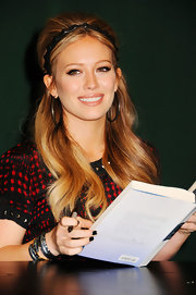 Hilary Duff wore a fantastic pair of large silver and gold hoops at a signing of her new book, 'Devoted'.