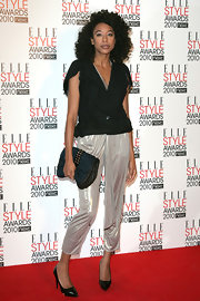Song bird Corrine Bailey Rae showed off her quilted Louis Vuitton clutch while attending the ELLE Style Awards.