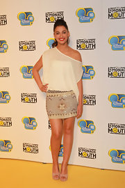 Naomi Scott showed some leg as she opted for a printed mini skirt at the UK gala of 'Lemonade Mouth.'