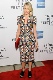 Naomi Watts rocked this stained glass-print dress and bright orange clutch while at the Tribeca Film Festival.