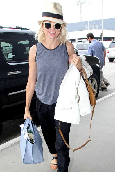 Naomi Watts in a summer tank and fedora.