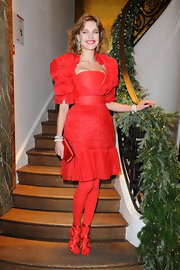 Natalie Vodianova was festive in all red for the Russian Fairy Tale jewelry launch in Paris.