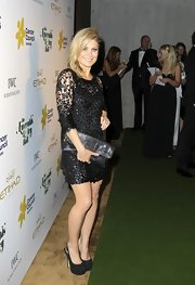 Natalie Bassingthwaighte attended the Emerald and Ivy Charity Ball wearing a lace LBD matched with her oversized purse and platform heels.