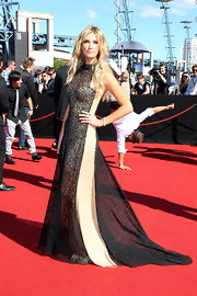 Delta Goodrem looked oh-so-glamorous at the ARIA Awards in a black and nude lace-overlay gown.