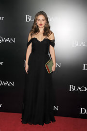 Natalie Portman accessorized her Dior gown with an Olympia Le-Tan Lolita clutch. The book style clutch fit her gothic inspired look perfectly.