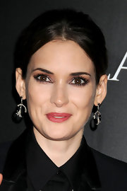 Winona Ryder showed off a glamorous pair of onyx and diamond hoop earrings.