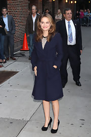 Natalie Portman looked effortlessly chic in suede black platform pumps. The heels looked fab paired with a navy wool coat.