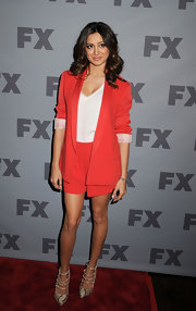 Noureen DeWulf was urban-chic wearing a red boyfriend blazer she teamed with a white undershirt and red shorts.