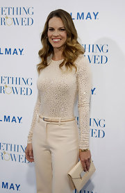 Hilary Swank complemented her luxe cream ensemble with a matching leather fall 2011 envelope clutch.