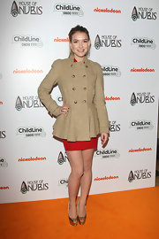 Nathalia Ramos topped her red dress with a double-breasted peplum coat at the premiere of 'Anubis.'