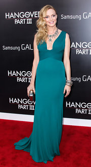 Heather Graham's teal gown featured a flattering wrap bust and showed off her toned figure.