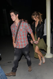 Delta Goodrem was dressed for comfort in nude gladiator sandals and a maxi dress during her movie date with Nick Jonas.