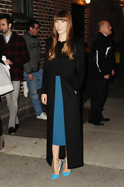 Jessica kept warm in NYC wearing this streamlined ankle-length black wool coat.