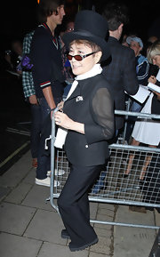 Yoko Ono looked ready to bust a move in a jaunty top hat at the Glamour Women of the Year Awards.