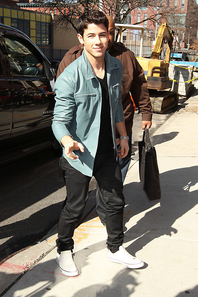 Nick Jonas gave his all black attire a boy band touch with a baby blue leather jacket.