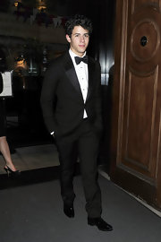 Nick looked dapper in a classic black tuxedo with his signature Jo-bro curls.