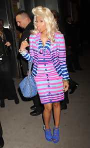 Nicki Minaj accented her blue stripes with cobalt sandals and a matching chain-trim purse.