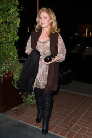 Kathy Hilton went for a '70s look with a boho outfit and black knee-high boots.
