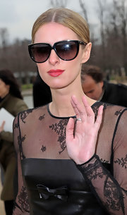 Nicky Hilton attended fashion week in Paris wearing a vibrant berry-colored lipstick.