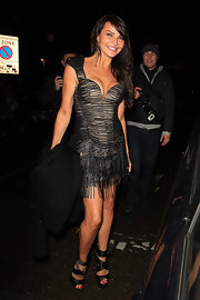 Lizzie Cundy sizzled in black satin wraparound platform sandals.