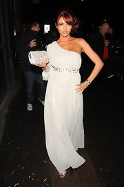 Amy Childs carried a glam white clutch adorned with silver sequins to Elen Rivas' birthday party.