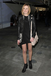 Laura Carmichael was out at London Fashion Week in a glam ensemble featuring a nude leather purse.