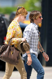 Nicole Kidman went for a stroll carrying a brown leather Yves Saint Laurent ChYc Cabas Tote.