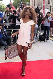 Sinitta was all legs in this super-short shift dress at the 'X-Factor' launch in London.