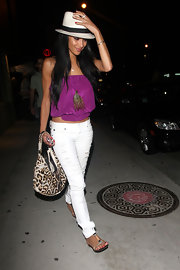Nicole paired her vibrant top and white jeans with a feathered necklace.