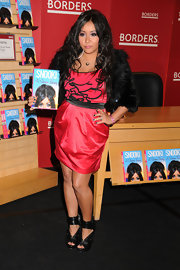 Snooki goes for bold ruffles in a black and hot pink cocktail dress.