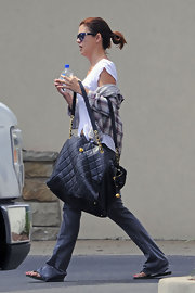 Kate Walsh was spotted on set of her new film carrying an oversize quilted black leather tote with gold hardware.