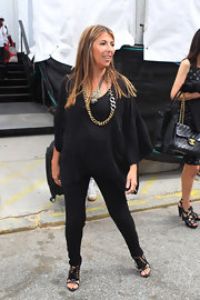 Nina Garcia wore a simple outfit at the 'Project Runway' fashion show, but that huge gold chain necklace made up for it.