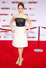 Debby Ryan chose a fitted, strapless dress that featured a black leather bodice and a floral skirt, for her look at the 'Iron Man 3' premiere.