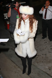 La Toya Jackson sported this pure white furry hat to match her snow bunny ensemble.