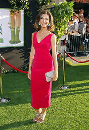 India de Beaufort wore a simple cut dress with a rich velvet texture and bright hue.