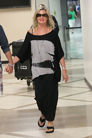 Olivia Newton-John wore an off-the-shoulder top upon arrival at LAX.