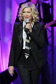 Olivia Newton-John pulled off a sequined blazer and slacks at a show in London.