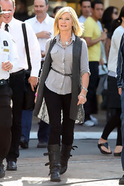 An ageless Olivia Newton John worked strappy gray flat boots. She paired the trendy boots with a long gray cardigan.